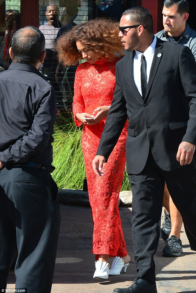 Classy:At first sight, the red-lace Kim Shui jumpsuit remained demure by pulling into a chic and sophisticated high neck, as well as long sleeves and floor-length trousers