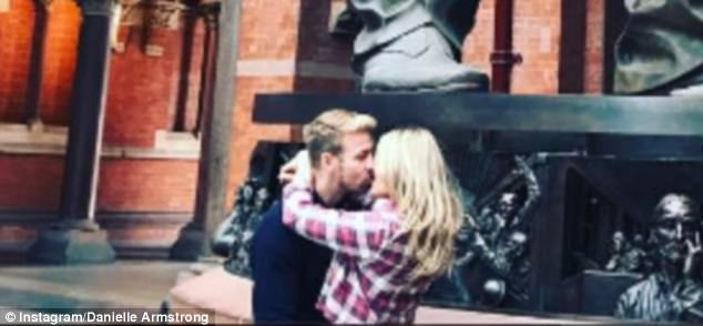 Close up:The 28-year-old former TOWIE star romantically clinched her boyfriend for the snap on which she added the caption: 'When you force your BF to kiss you under a kissing statue'