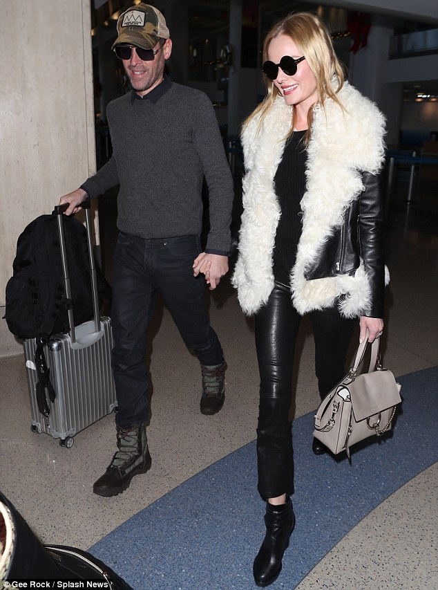 Edgy: The blonde beauty added a pair of cropped, bell leggings and a set of high-heel ankle boots to her look