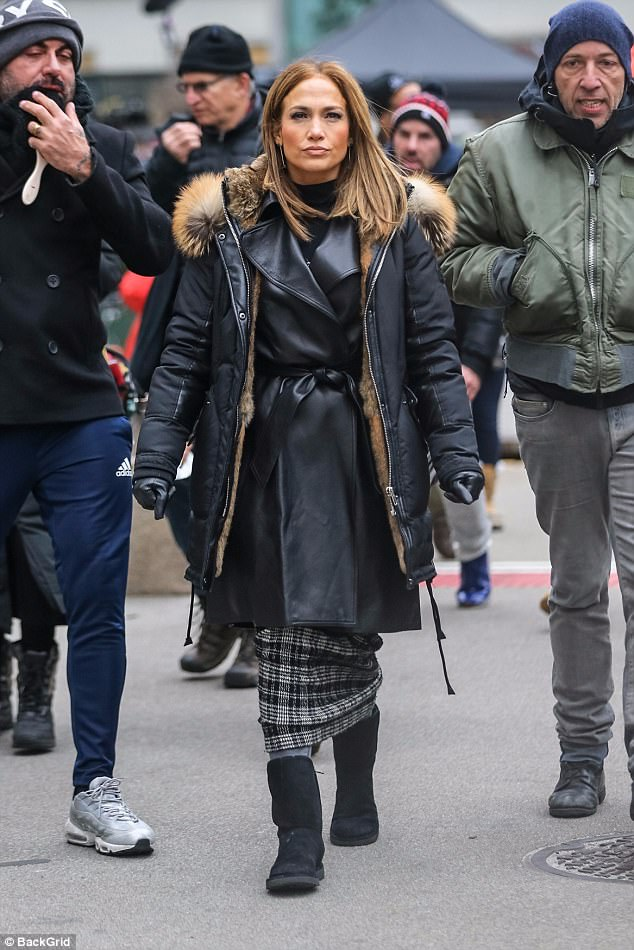 Bundle up!In between scenes, Jennifer kept warm in gray tights, black snow boots, and a puffer jacket
