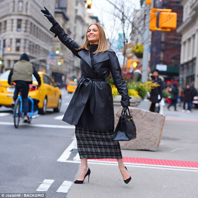 Working girl!Jennifer stepped out in chic work wear with a plaid midi dress, teamed with a black leather pea coat that she tied at the waist