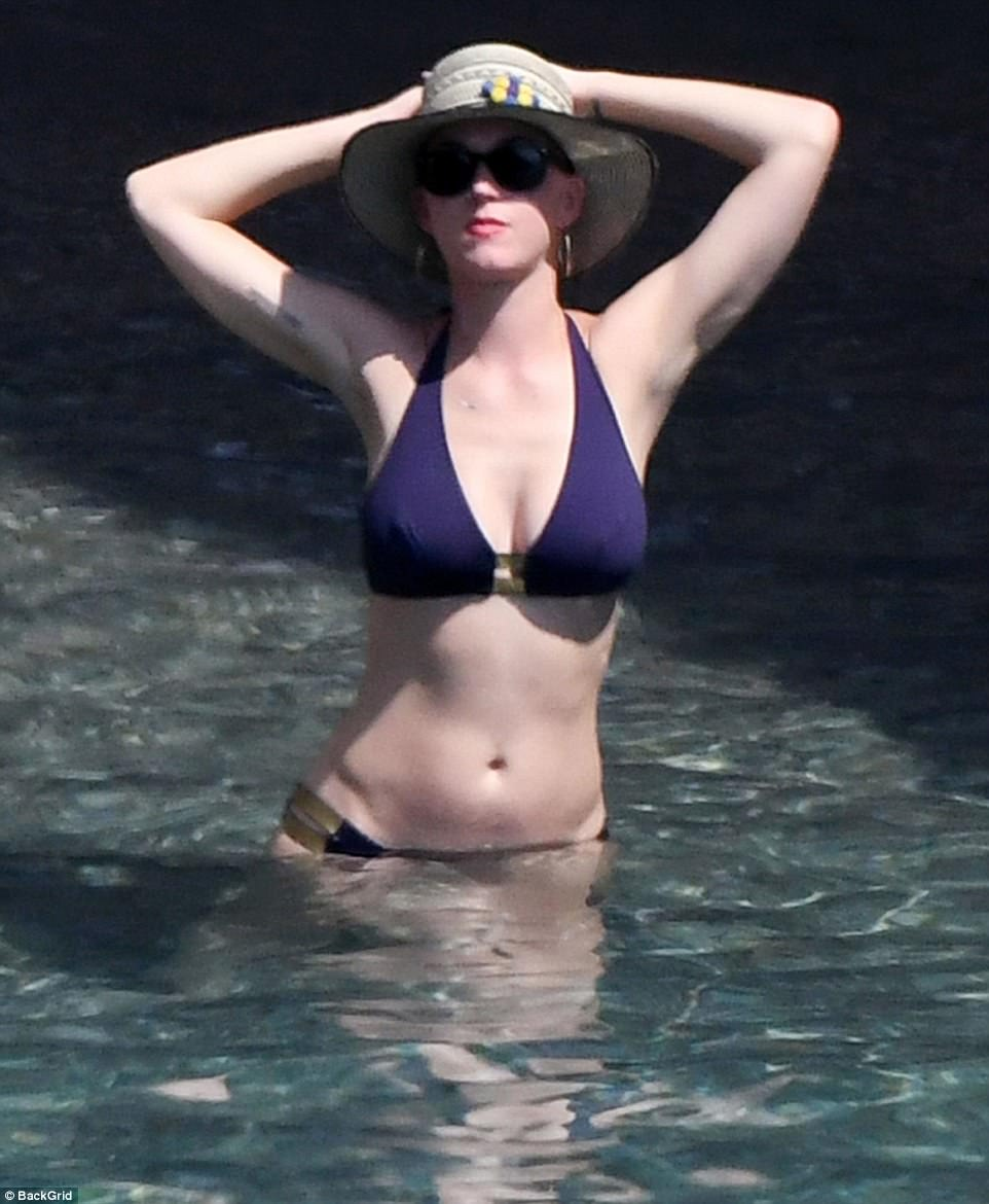 Don't mind me: But the American star was hard to miss as she stretched her hands behind her head