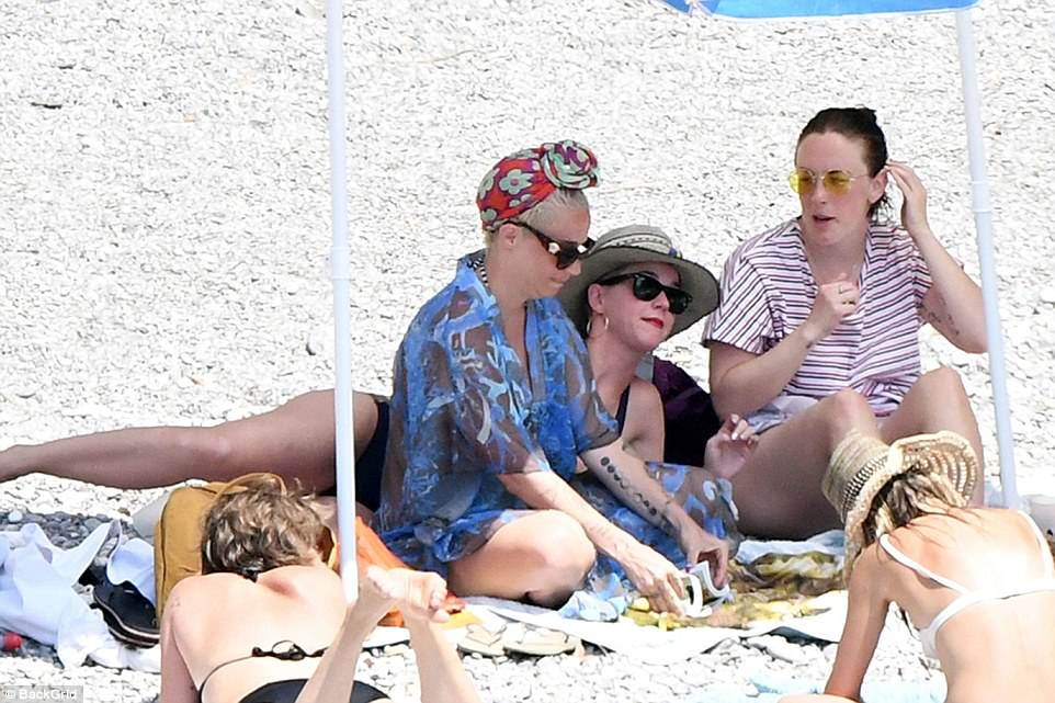 In the mix: The star idled with pals as they soaked up the sun during their protracted stay on the beach