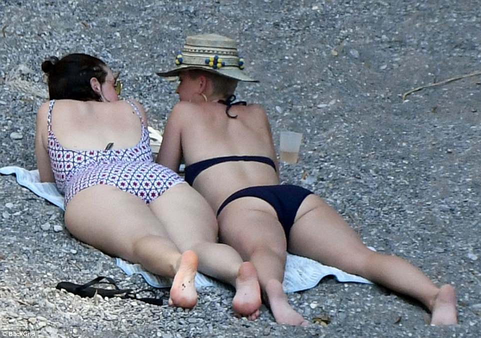 Side by side: The two pals had plenty to talk about while relaxing on a beach towel