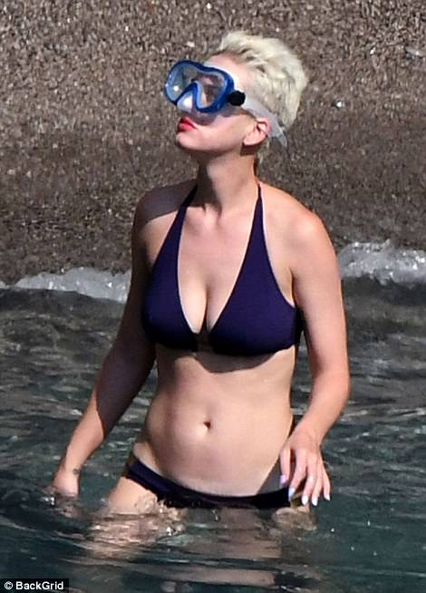 Google fox: The star pulled on a pair of goggles before wading into the shallows for a spot of snorkeling