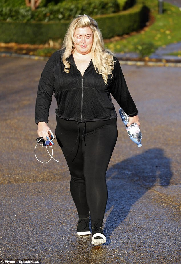Busy:The 36-year-old TOWIE star cut a sporty figure in a tracksuit as she covered up her sensational curves in the comfortable attire