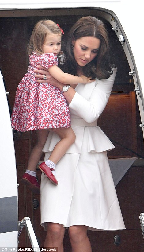 The Duchess of Cambridge carried her two-year-old daughter from the plane and down the steps