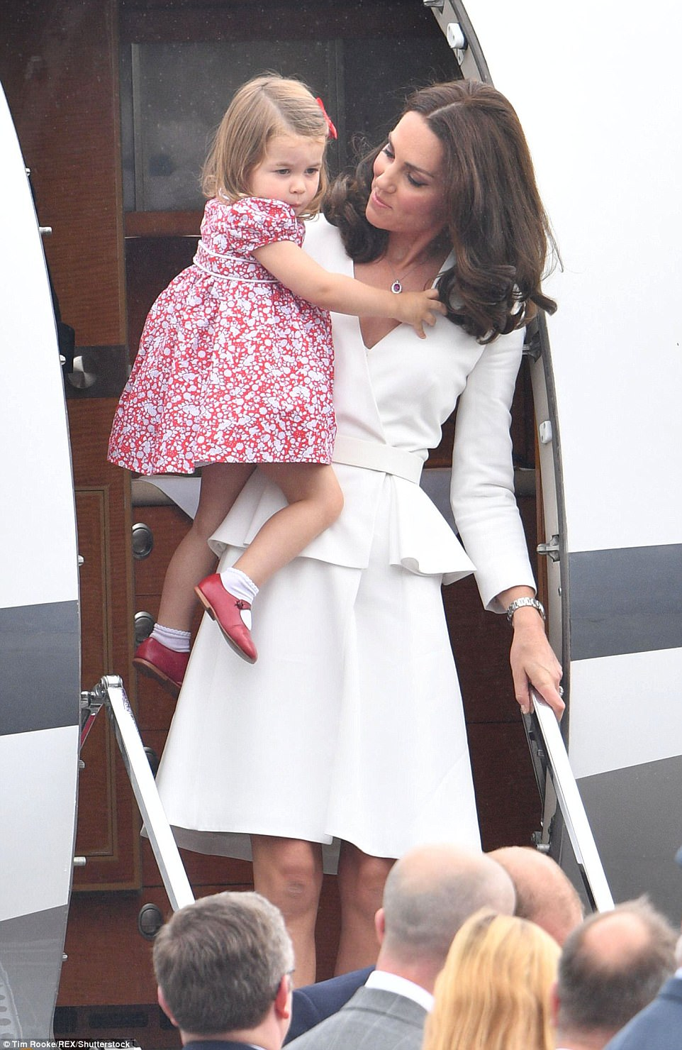 Princess Charlotte was pretty as a picture in a floral dress with adorable red shoes and white socks. The trip is likely to be seen as another Brexit diplomacy tour, helping to maintain and strengthen the UK's relations with Europe as it leaves the EU