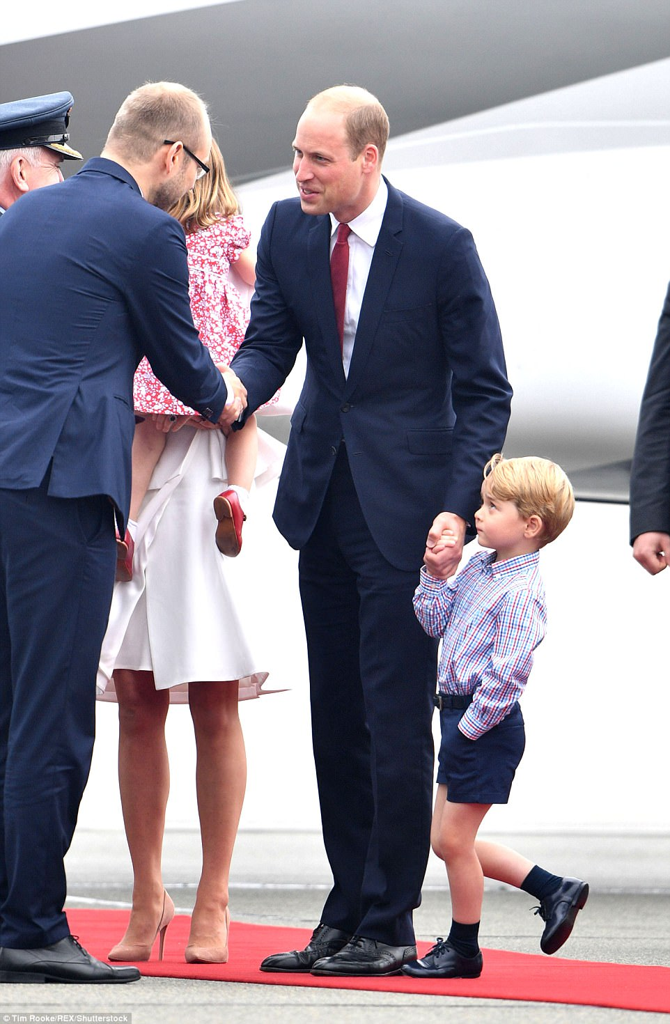 Prince George looked a little in awe as his father and mother were officially welcomed to Poland. This week the family will tour the site of Gdansk's shipyards, the birthplace of Poland's Solidarity movement that helped topple Communist rule