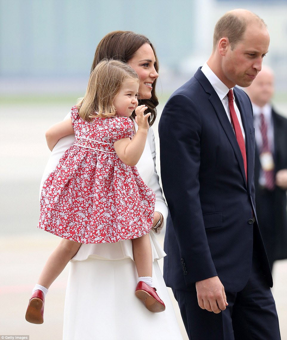 The royal wave! While George may be feeling a little shy, his younger sister is already a natural on official engagements. The adorable two-year-old wore a red dress with white floral detail and a pair of matching T-bar shoes and socks