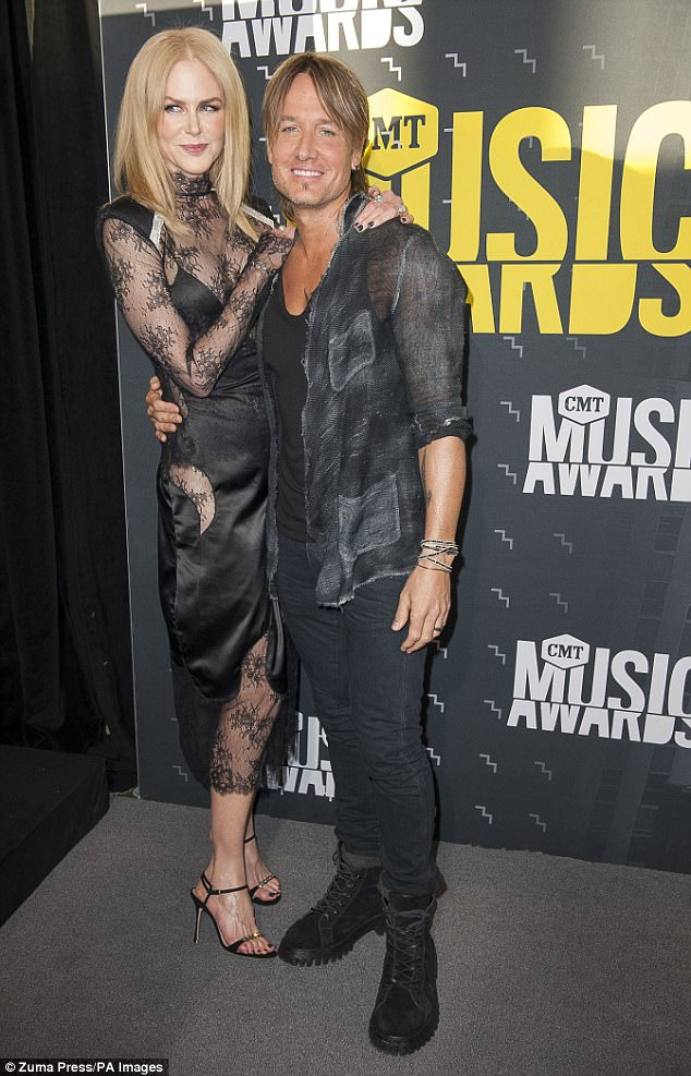Her love: Keith is married to country singer Keith Urban - pictured together at the CMT music awards in June