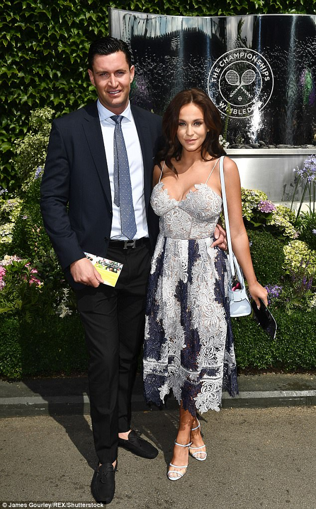 Loved up: The couple pictured at the Wimbledon Tennis Championships in London on July 8