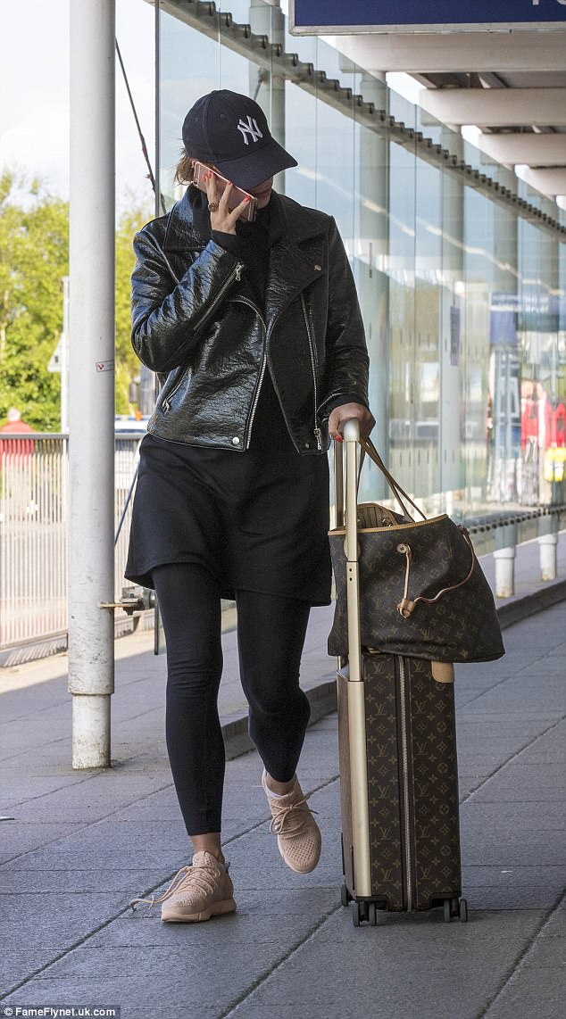 Miss McCann appeared to be on the phone the whole time during the walk through arrivals