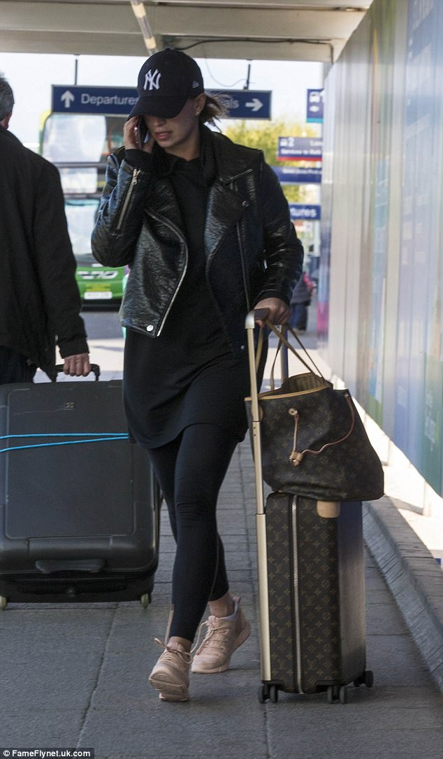 She appeared nervous as she arrived back on home soil after becoming embroiled in the controversy surrounding the arrest of her partner