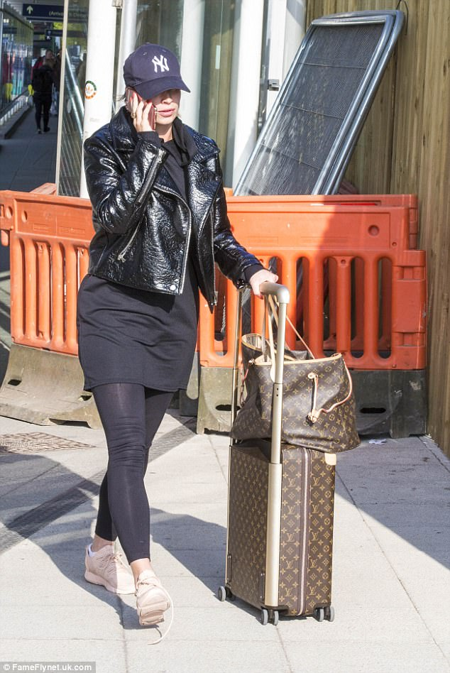 She was wearing black leggings and a black leather jacket and trainers, seeming to dress down as she arrived at the airport today