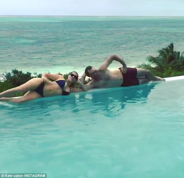 Silly:Kate Upton had a little fun on Instagram Sunday. The blonde beauty shared an image where she and fiance Justin Verlander were coming out of a swimming pool during their Caribbean vacation