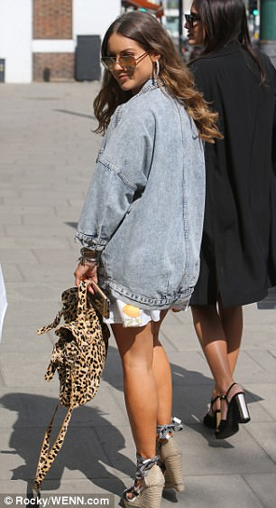 On trend as ever! The Instagram starlet sashayed down the sidewalk to the shower in open-toe lace up sandals