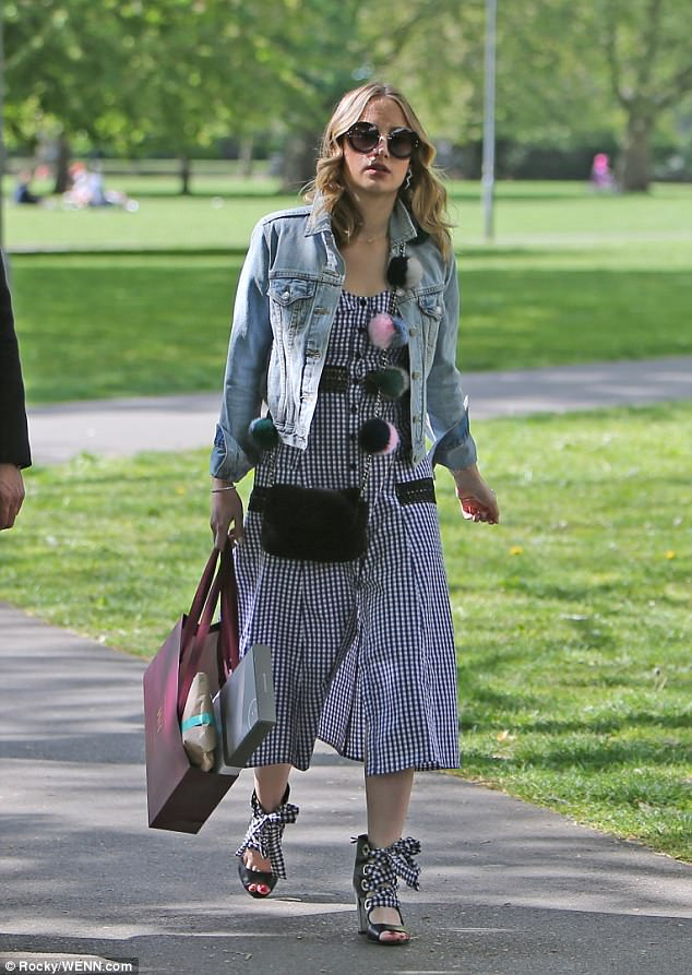 Stand out! Rosie Fortescue showed off her slender frame in a checkered playsuit, with matching ribbon sandals