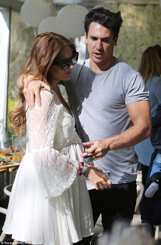 The happy couple: JP pulled his girlfriend in for a sweet embrace in front of their guests - caressing her bump as he did so