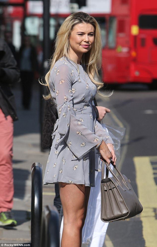Stunning:Georgia Toffolo also made a glamorous arrival in a eye-wateringly short chiffon dress, patterned with pretty white butterflies