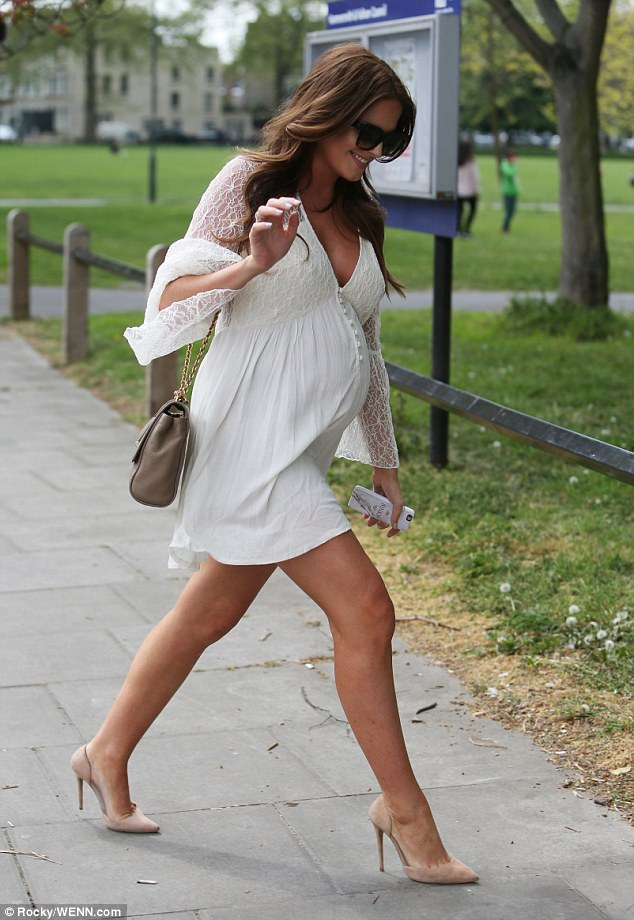 Angelic: Proving her style has not faltered in pregnancy, Binky opted for a soft white mini dress, which was both sophisticated and sexy with its plunging neckline and lace sleeves