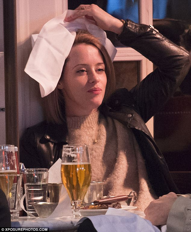 That's not how a queen should behave!The actress, who plays Queen Elizabeth II, displayed her more playful side as she fooled around with a napkin at the table - leaving Matt in hysterics