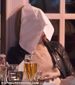 Hilarious: The star went on to drape the napkin over her entire face