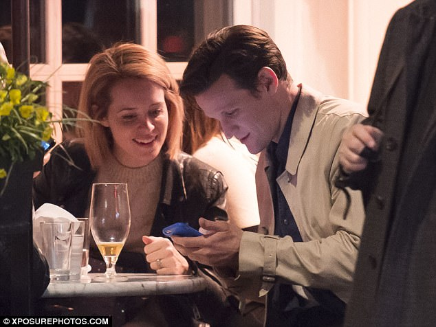 Tech time: Matt was later seen making Claire laugh as he showed her something on his phone as they caught up after a few weeks away from filming