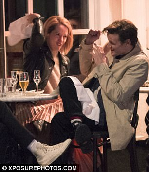 Stop teasing! Claire was seen playfully scolding Matt with the serviette as the joked around with friends during the meal