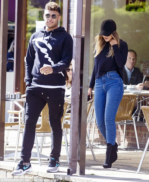 Too cool: Perrie clad her long shapely pins in skinny jeans, and channelled an urban cool look with a black baseball cap pulled low over her face