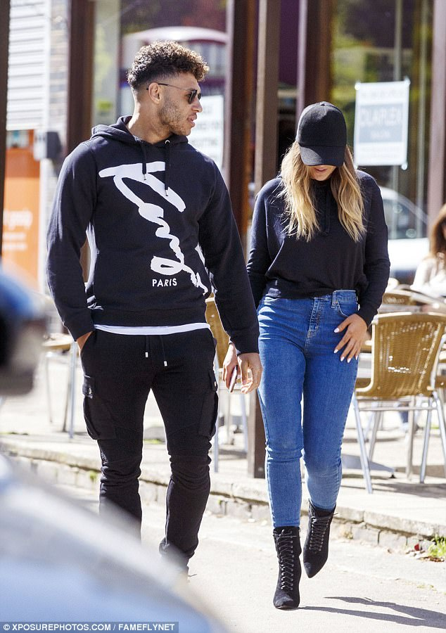 Loved up: Perrie Edwards, 23, looked more loved up than ever with her footballer beau Alex Oxlade-Chamberlain, also 23, in London