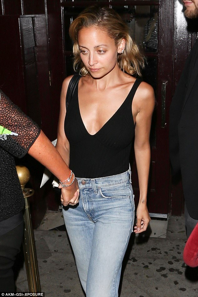 Lovely lady: She normally covers up in boho dresses. But on Saturday evening Nicole Richie let her chest show