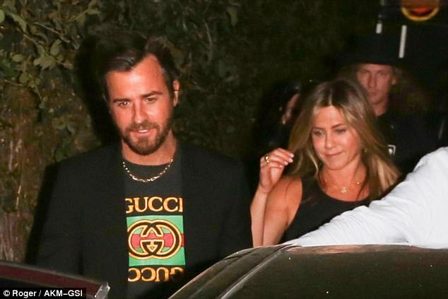 So in love: Also at the Meyer bash was Jennifer Aniston with husband Justin Theroux, who wore a Gucci T-shirt