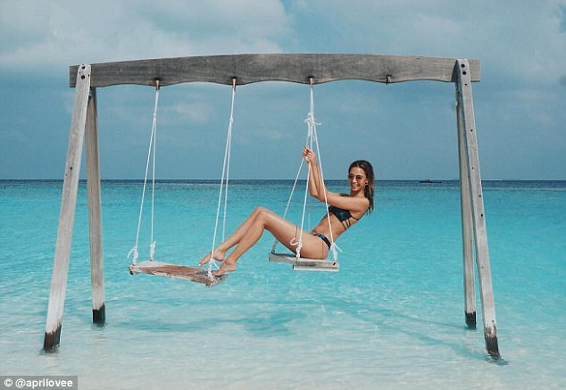 Looking good: The stunner posed in a variety of ways on the swing above the water
