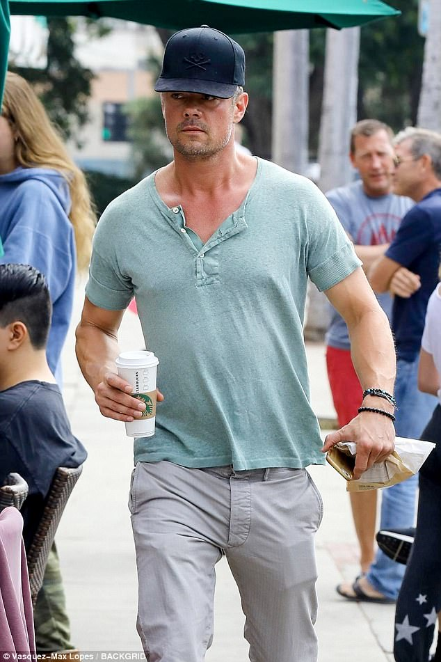 Muscles:He rocked a form fitting turquoise tee that let his fit physique shine through as he walked with a cup of coffee