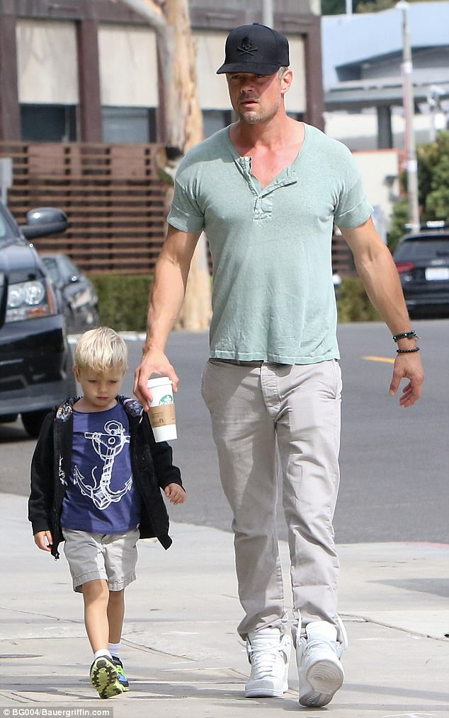 Doting single dad:Josh Duhamel, 44, was seen without his wedding ring as he took his four-year-old son Axl around town in Los Angeles on Monday