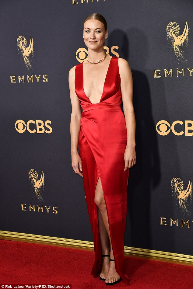 Off the market!When Yvonne Strahovski hit the 69th annual Emmy Awards in Los Angeles on Sunday evening, she had some news to break