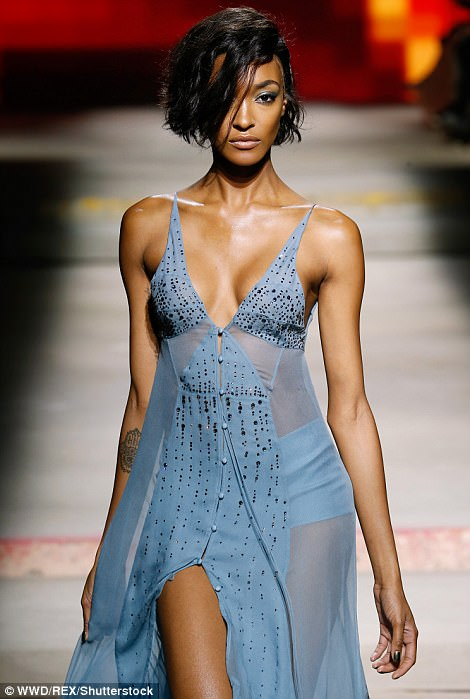 Glam girls: Jourdan and Joan sported the same mesh maxi gown,which cut into mesh panels at the side to give a glimpse of their toned frames and skimpy briefs underneath