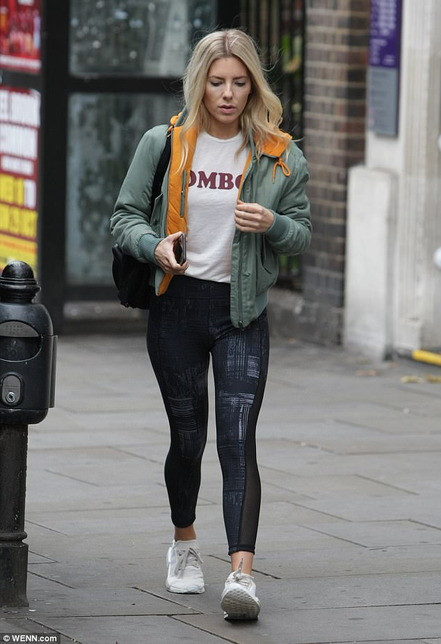 Sports-luxe:Mollie looked ready for a day of intense training as she arrived at the dance studios in a pair of monochrome mesh-insert leggings and white trainers