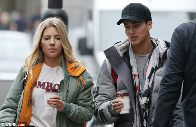 Similar vibes:AJ mirrored his dancing partner's casual look himself with a padded jacket, a printed scarf and black jogging bottoms