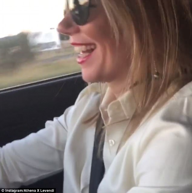 All smiles: Video of her driving the car, believed to be taken by her husband, shows her ecstatic to be driving her new ride as the sunsets