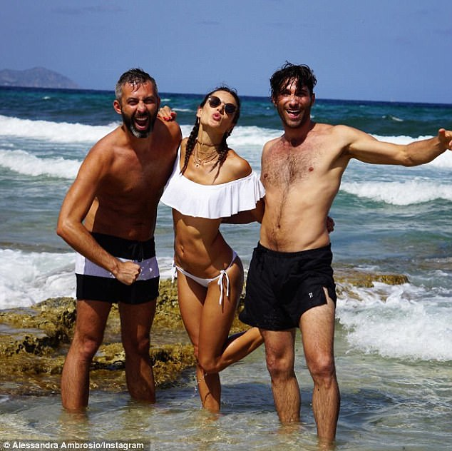 Kisses from Spain: The beautiful model took a photo with Milan and Dominick; she captioned it: 'Safe and sound with my boys #IslandLife'