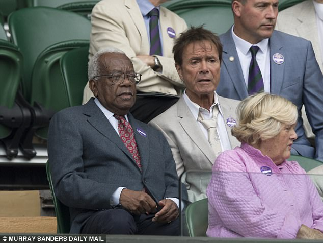 Catching up? Sir Trevor McDonald and Cliff were seen deep in conversation in the stand