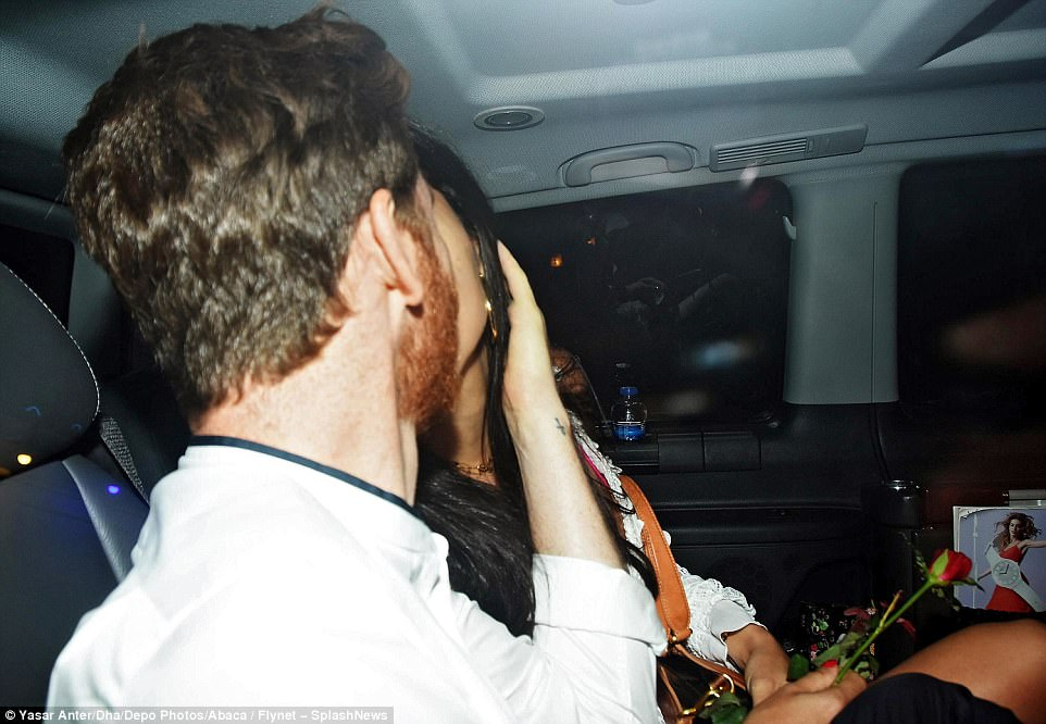 Smooch: The new couple couldn't keep their hands off of each other as they puckered up in the taxi home