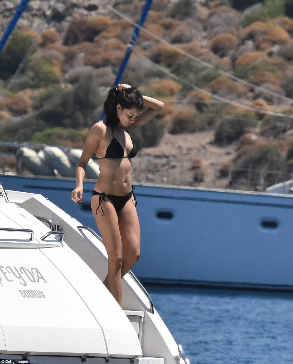 Bronzed: The beauty was seen topping up her tan as she basked in the Turkish sunshine on board