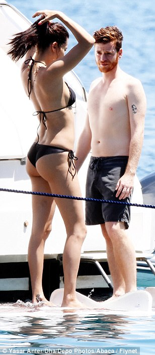 Peachy! Her bikini bottoms boasted an eye-wateringly high cut at the back, meaning her pert posterior was left firmly on view, along with her runway worthy pins, as she frolicked in the sunshine and sea with her new man