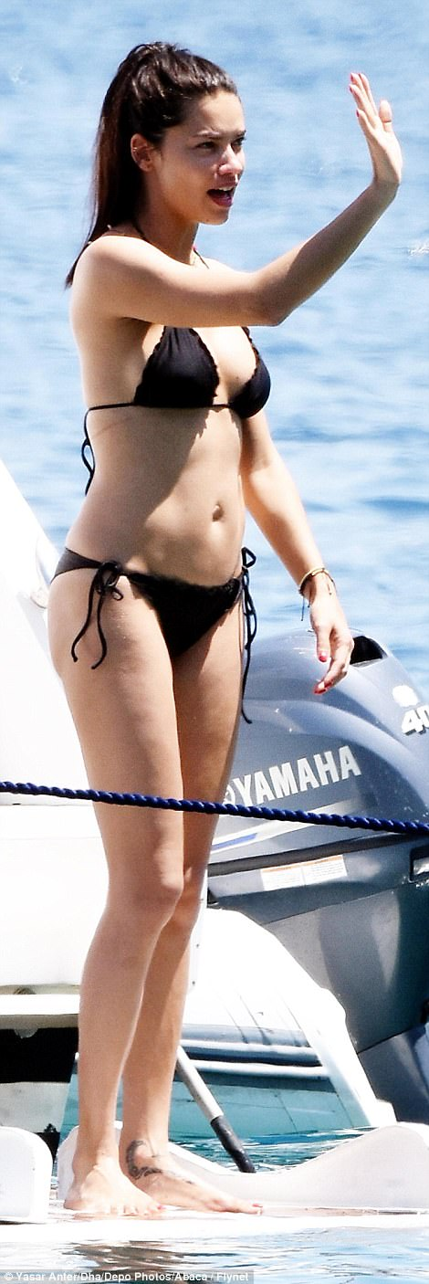 Bikini-clad: Making the most of their romantic getaway in Metin's home town, Adriana chose to don a revealing two-piece that perfectly showcased her best assets