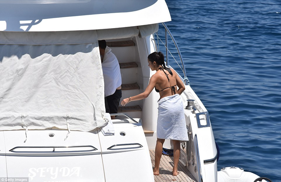 Covering up: She was seen wrapping a towel around her waist in an attempt to get dry