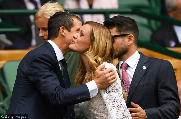 Pucker up: Bear, who ditched his combats for a dapper suit, leaned in to greet Katherine with a kiss