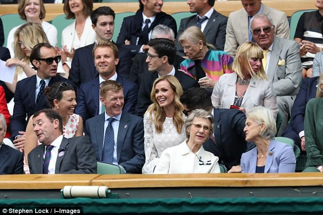 Serving up a style ace: The blonde beauty shone in her ivory dress as she mingled with other celebrities at the match